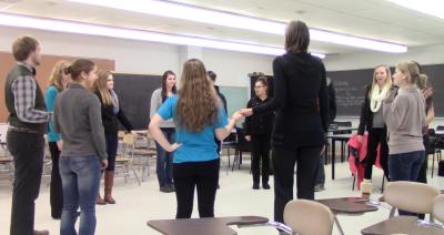 Students dancing salsa rueda