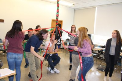 Students dancing around a maypole in their mathematics class.