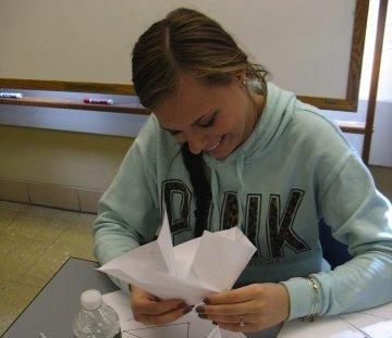 Student exploring straight-cut origami