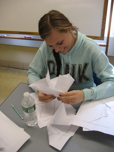 Student folding straight-cut origami